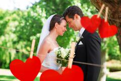 Stock Photo of Composite image of loving newly wed couple in garden