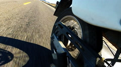 View Of Motorcycle Rear Wheel Rolling Desert Highway Stock Footage