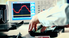 Electronic components and oscilloscope in laboratory Stock Footage