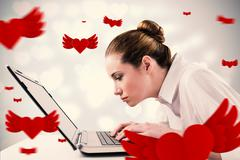 Composite image of attentive businesswoman typing on laptop - stock illustration