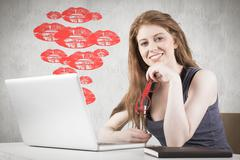 Stock Illustration of Composite image of pretty redhead working on laptop