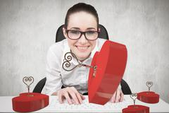 Stock Illustration of Composite image of businesswoman typing on a keyboard