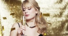 Sexy Woman dancing new years party drinking champagne gold glitter background - - stock footage