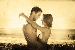 Composite image of sexy couple embracing - stock photo