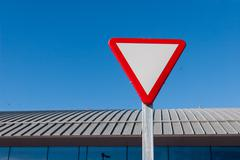 Yield sign Stock Photos