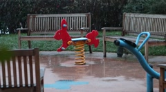 Under the snow on the playground, wet toy. Stock Footage