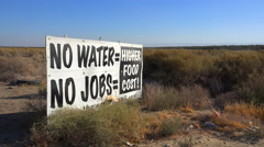 A road sign warns of s serious drought and the cost to California in jobs and Stock Footage