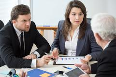 Discussion between businesspeople Stock Photos