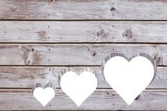 Stock Photo of Hearts cut out in wood