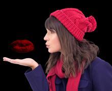 Composite image of festive brunette blowing a kiss Stock Illustration