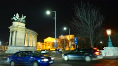 Traffic pass by at the Heroes Square in Budapest at night Stock Footage
