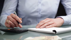 Accountant or Assistant Calculating Money - stock footage