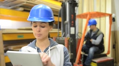 Smiling woman working in warehouse Stock Footage