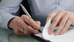 Business Manager or Leader Signs Documents Stock Footage