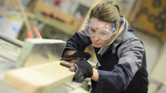 Young woman in carpentry professional training - stock footage