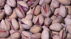 Stock Video Footage of 4K roasted salted appetizing pistachios rotating. UHD stock video