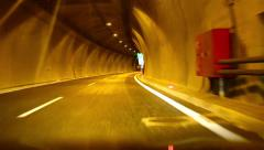 HD car driving on highway at night through tunnel Stock Footage