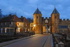 The medieval gate Koppelpoort in the Dutch town Amersfoort in the evening Stock Photos