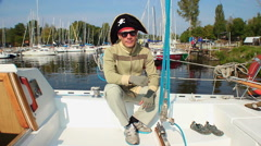 Simple guy wearing tricorn pirate hat, yachting, adventures Stock Footage