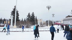 People have fun on skating rink in Moscow VDNKh. Russia Stock Footage