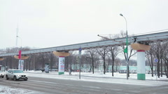 Moscow monorail train drives on overpass at winter streets. Moscow, Russia Stock Footage