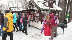 People look at Russian samovar (self-boiler) at Christmas fair. Traditional food Stock Footage