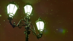 Winter evening. Snow flies past a street lamp in the old style. Defocused. Stock Footage