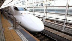 Bullet train arrival to station platform, Tokyo, Japan Stock Footage