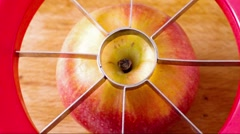 Cutting an apple into slices with a special tool Stock Footage