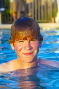 child has fun in the outdoor pool - stock photo