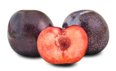 Whole plums and half Stock Photos