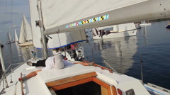 Man lying on deck sailing yacht, having rest before race Stock Footage