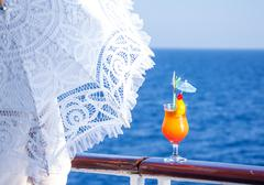 Girl with an umbrella to enjoy the journey drinking  cocktail Stock Photos