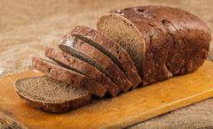 sliced loaf brown bread - stock photo