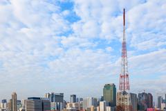 many clouds cover the cityscape business building with antenna tower pole for - stock photo