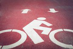 Bicycle lane or path, icon symbol on asphalt road - stock photo