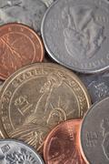US American coin and many international currency Stock Photos