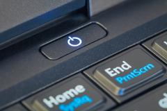 power button icon sign on notebook computer - stock photo