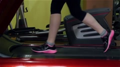 Attaractive girl doing an exercise on fitness track in the gym, slow motion Stock Footage