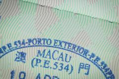 Admitted stamp of macau Visa for immigration travel concept Stock Photos