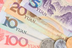 Chinese or Yuan banknotes money and coins from China's currency, close up vie - stock photo