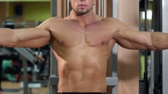 Muscular man training his hands in the gym Stock Footage