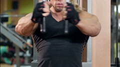 Handsome muscular man in the gym wearing training his hands Stock Footage