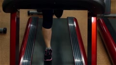 Running girl on fitness track in the gym, slow motion Stock Footage