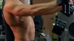 Stylish muscular man training his hands in the gym, slow motion Stock Footage