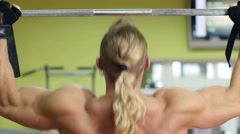 Strong man doing pull-ups on a bar in gym Stock Footage