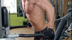 Muscular sportsman doing exercises for his hands in the gym, close up Stock Footage