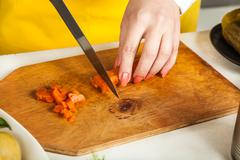 Chef woman cuts Stock Photos