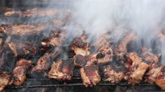 Pork ribs on barbecue grill Stock Footage
