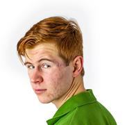Cool boy in green shirt with red hair Stock Photos